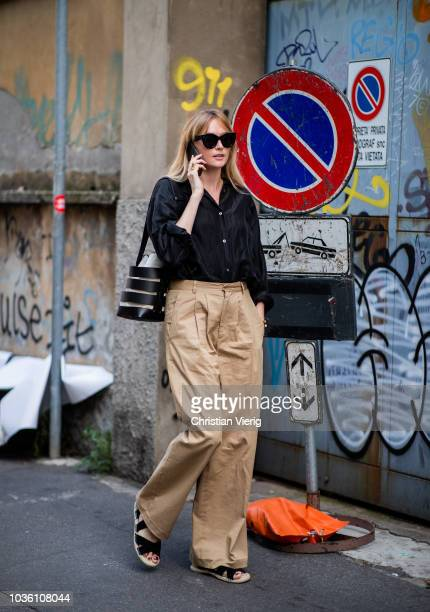 A guest wearing beige wide leg pants is seen outside Jil Sander during Milan Fashion Week Spring/Summer 2019 on September 19 2018 in Milan Italy