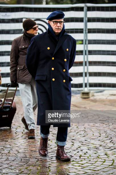 A guest wearing beret and a wool coat is seen during the 93 Pitti Immagine Uomo at Fortezza Da Basso on January 11 2018 in Florence Italy