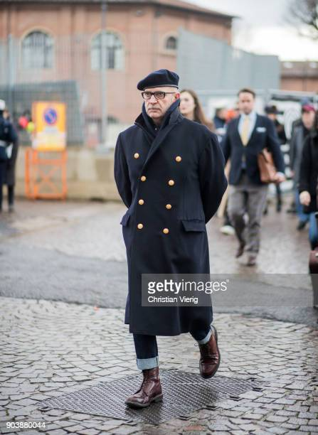 A guest wearing beret wool coat is seen during the 93 Pitti Immagine Uomo at Fortezza Da Basso on January 11 2018 in Florence Italy