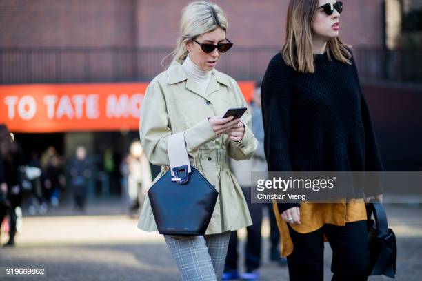A guest wearing black bag seen outside Ports 1961 during London Fashion Week February 2018 on February 17 2018 in London England