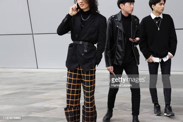 Guest wearing black blazer with a belt and yellow check pants is seen at the Hera Seoul Fashion Week 2019 F/W at Dongdaemun Design Plaza at...