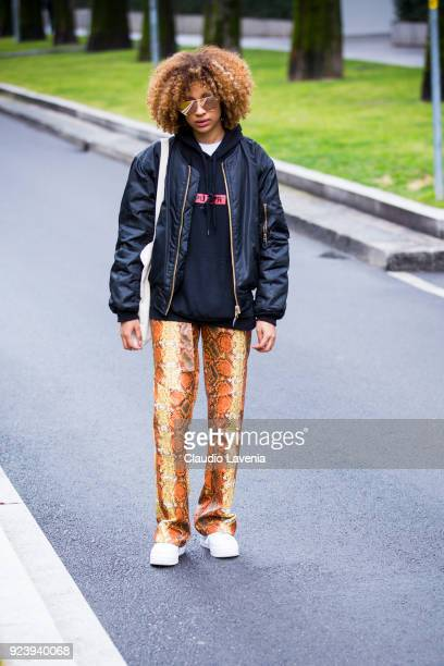 Guest wearing black bomber and python pants is seen outside Giorgio Armani show during Milan Fashion Week Fall/Winter 2018/19 on February 24 2018 in...