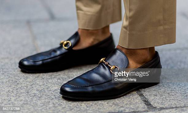 A guest wearing black Gucci loafer outside Louis Vuitton during the Paris Fashion Week Menswear Spring/Summer 2017 on June 23 2016 in Paris France