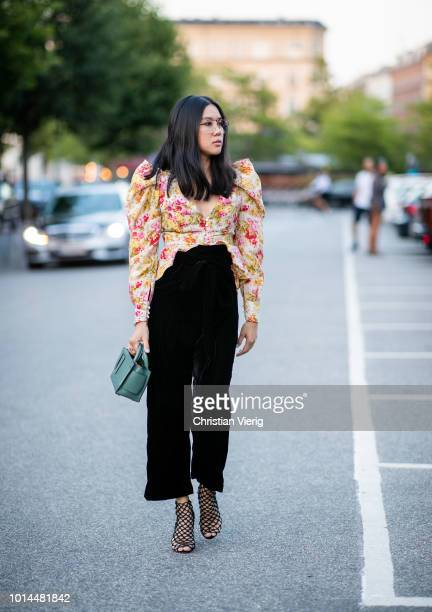 A guest wearing black high waist pants seen outside Saks Potts during the Copenhagen Fashion Week Spring/Summer 2019 on August 9 2018 in Copenhagen...