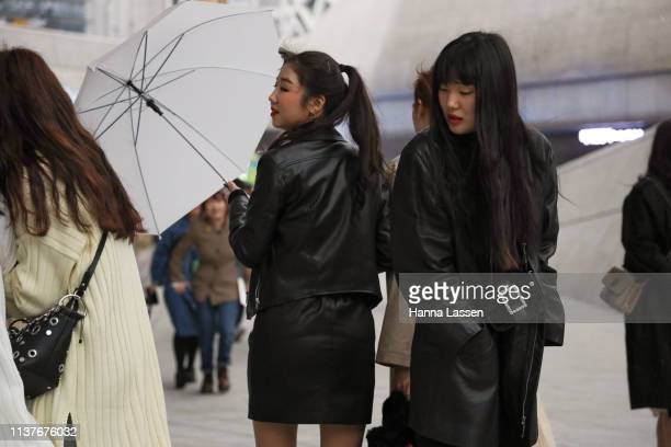 Guest wearing black leather jacket with black clutch is seen at the Hera Seoul Fashion Week 2019 F/W at Dongdaemun Design Plaza at Dongdaemun Design...
