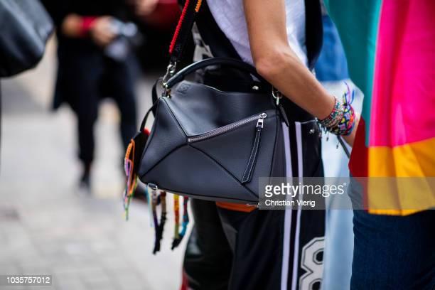 A guest wearing black Loewe bag is seen outside Natasha Zinko during London Fashion Week September 2018 on September 18 2018 in London England