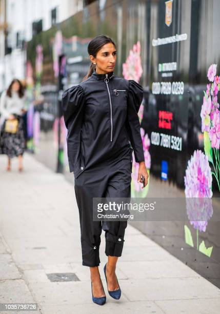 A guest wearing black overall with zipper is seen outside Natasha Zinko during London Fashion Week September 2018 on September 18 2018 in London...