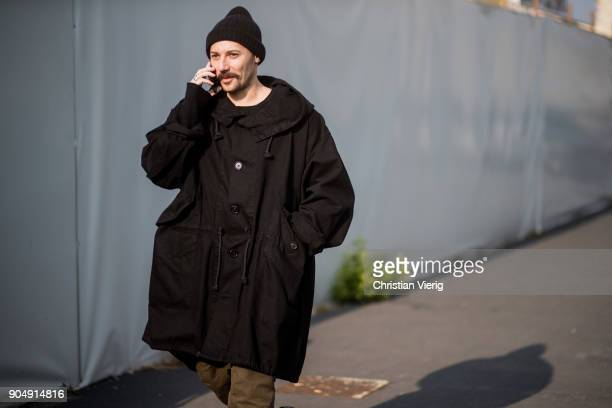 A guest wearing black parka beanie is seen outside DSquared2 during Milan Men's Fashion Week Fall/Winter 2018/19 on January 14 2018 in Milan Italy
