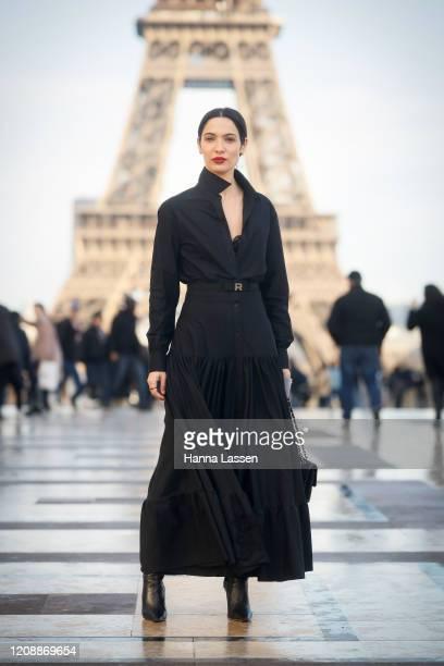 Guest wearing black Rochas maxi dress outside the Rochas show during the Paris Fashion Week Womenswear Fall/Winter 2020/2021 on February 26, 2020 in...