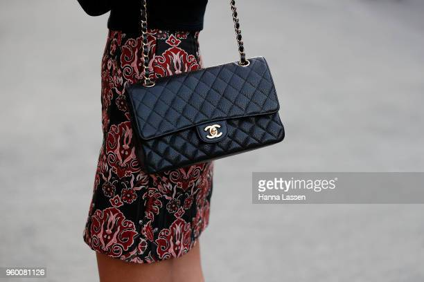 A guest wearing black top and Chanel bag during MercedesBenz Fashion Week Weekend Edition 2018 at Carriageworks on May 19 2018 in Sydney Australia