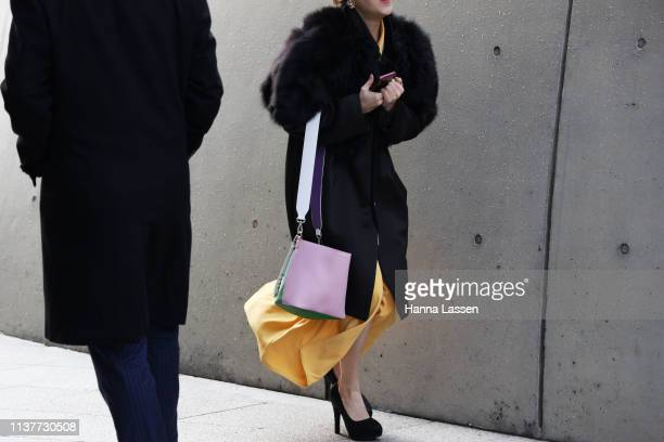 Guest wearing black trench fur bolero yellow maxi skirt and pink bag is seen at the Hera Seoul Fashion Week 2019 F/W at Dongdaemun Design Plaza at...
