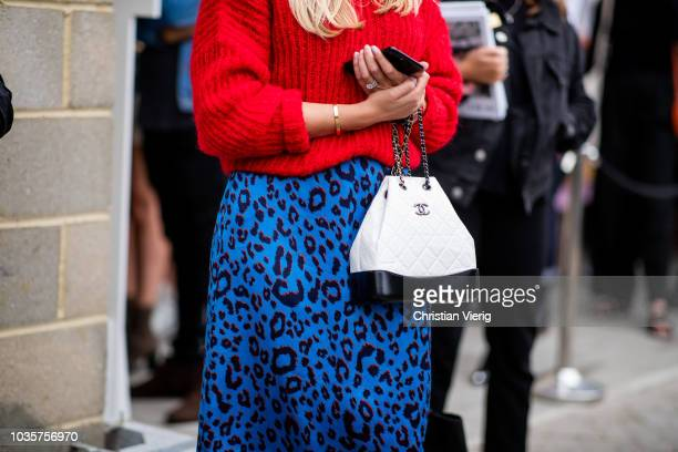 A guest wearing black white Chanel bag is seen outside Natasha Zinko during London Fashion Week September 2018 on September 18 2018 in London England