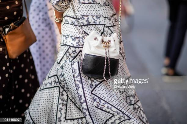 A guest wearing black white Chanel bag seen outside Saks Potts during the Copenhagen Fashion Week Spring/Summer 2019 on August 9 2018 in Copenhagen...