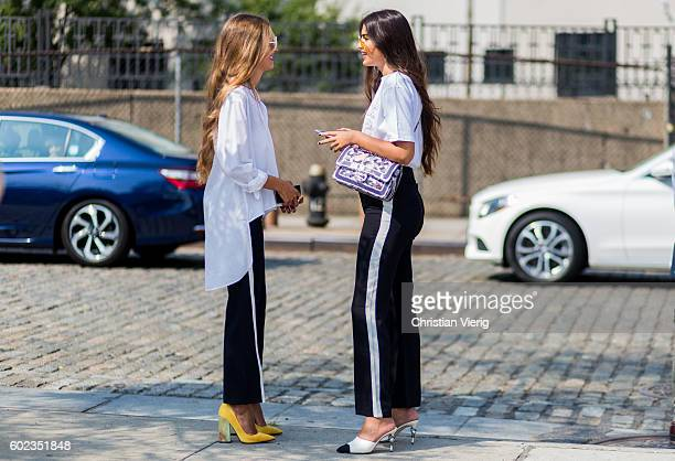 Guest wearing black white track suit pants and heels outside Lacoste on September 10 2016 in New York City