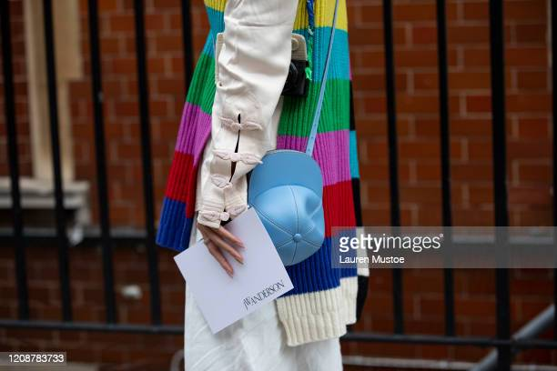 Guest wearing block colour knitted jumper attends JW Anderson during London Fashion Week February 2020 on February 17, 2020 in London, England.