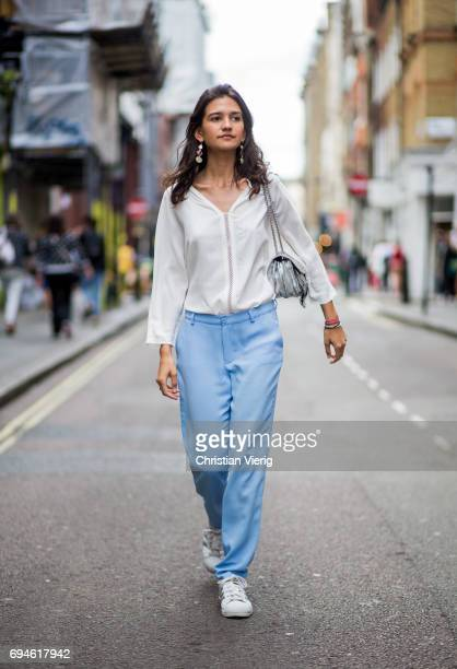A guest wearing blouse and blue jogger pants during the London Fashion Week Men's June 2017 collections on June 10 2017 in London England