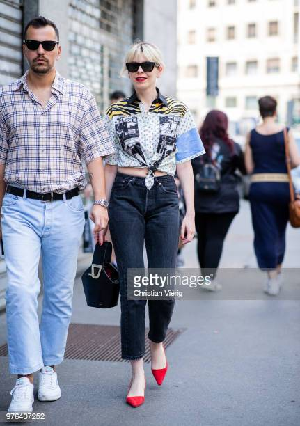 A guest wearing blouse denim jeans red pointed flats is seen outside Marni during Milan Men's Fashion Week Spring/Summer 2019 on June 16 2018 in...