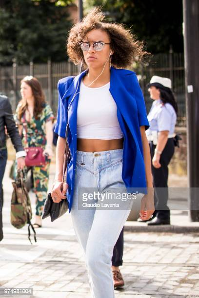 A guest wearing blue blazer and light blue jeans is seen during the 94th Pitti Immagine Uomo at Fortezza Da Basso on June 14 2018 in Florence Italy