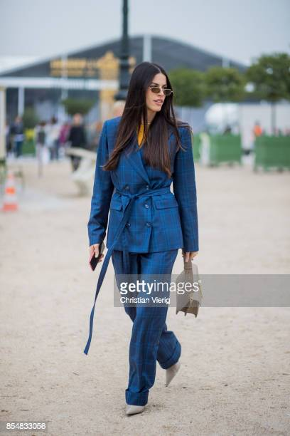 A guest wearing blue checked suit JW Anderson bag is seen outside Lacoste during Paris Fashion Week Spring/Summer 2018 on September 27 2017 in Paris...