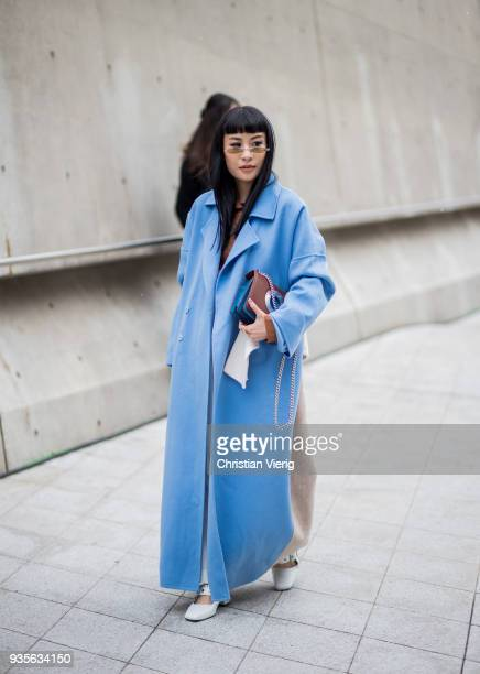 A guest wearing blue coat is seen at the Hera Seoul Fashion Week 2018 F/W at Dongdaemun Design Plaza on March 21 2018 in Seoul South Korea