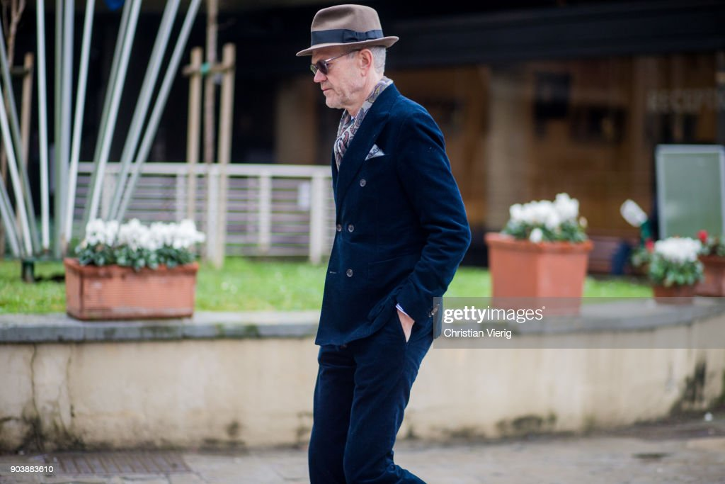 a guest wearing blue corduroy suit hat is seen during the 93 pitti