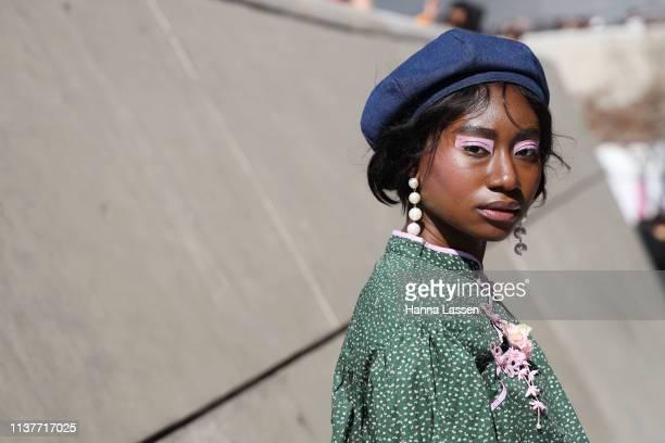 Guest wearing blue denim beret green shirt and pink eye shadow is seen at the Hera Seoul Fashion Week 2019 F/W at Dongdaemun Design Plaza at...