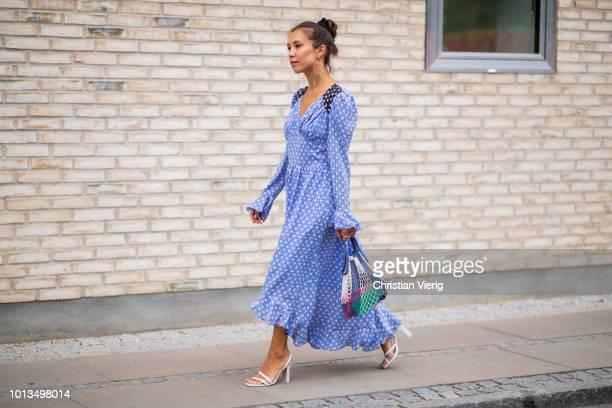 Guest wearing blue dress, net bag is seen outside Stine Goya during the Copenhagen Fashion Week Spring/Summer 2019 on August 8, 2018 in Copenhagen,...