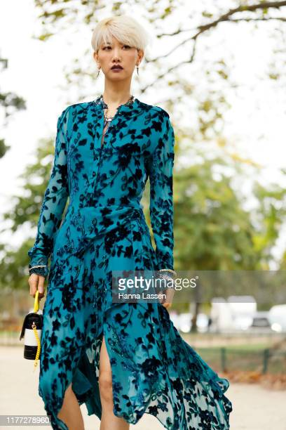 Guest wearing blue dress with floral details and Chloe bag outside Chloe during Paris Fashion Week - Womenswear Spring Summer 2020 on September 26,...