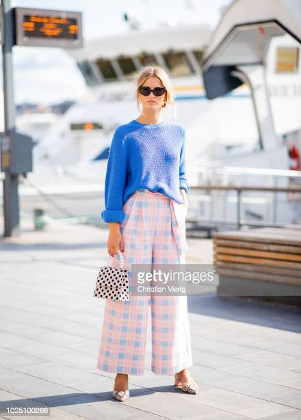 A guest wearing blue knit checked pants is seen during Stockholm Runway SS19 on August 29 2018 in Stockholm Sweden