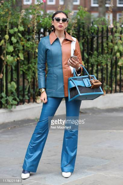 Guest wearing blue leather trousers and jacket at Erdem at Gray's Inn Gardens during London Fashion Week September 2019 on September 16 2019 in...