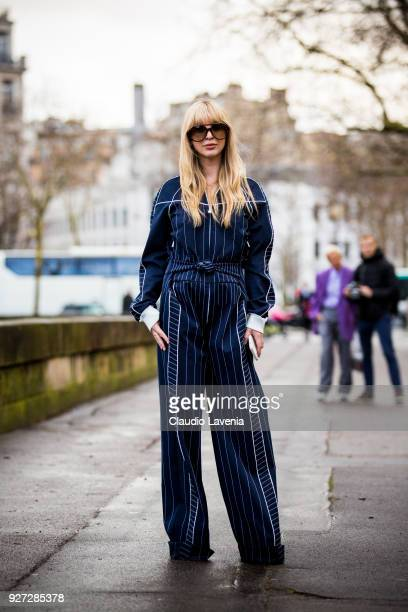 A guest wearing blue striped jumpsuit is seen in the streets of Paris before the Valentino show during Paris Fashion Week Womenswear Fall/Winter...