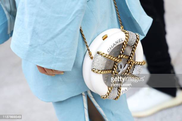 Guest wearing blue suit and white Chanel clutch is seen at the Seoul Fashion Week 2019 F/W at Dongdaemun Design Plaza at Dongdaemun Design Plaza on...
