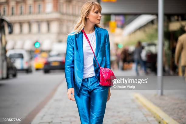A guest wearing blue suit red bag during Stockholm Runway SS19 on August 30 2018 in Stockholm Sweden