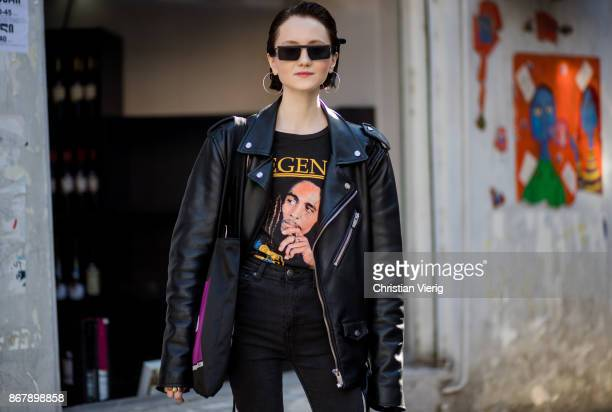 A guest wearing Bob Marley fan tshirt black leather jacket skinny jeans sunglasses earrings is seen during Tbilisi Fashion Week Spring/Summer 2018 on...