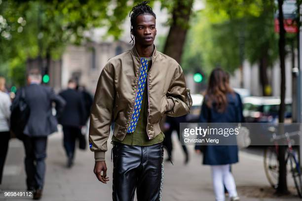 A guest wearing bomber jacket leather pants is seen outside Iceberg during London Fashion Week Men's June 2018 on June 8 2018 in London England