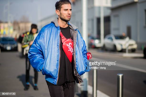 A guest wearing bomber jacket Supreme bag is seen outside DSquared2 during Milan Men's Fashion Week Fall/Winter 2018/19 on January 14 2018 in Milan...