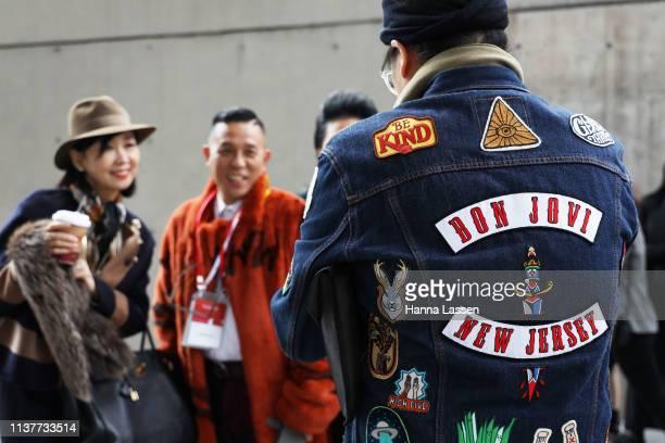 Guest wearing Bon Jovi denim jacket is seen at the Hera Seoul Fashion Week 2019 F/W at Dongdaemun Design Plaza at Dongdaemun Design Plaza on March 23...