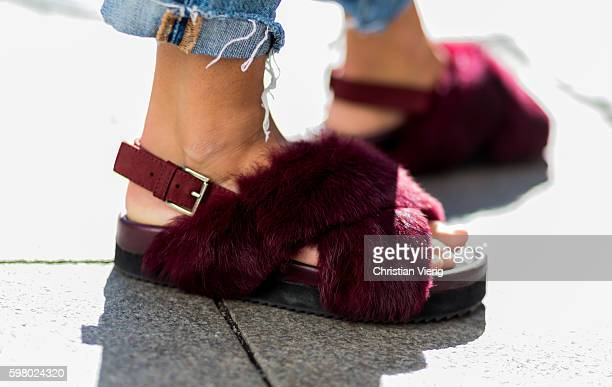 A guest wearing bordeaux fluffy sandals outside Schwedish Fashion Talents during the second day of the Stockholm Fashion Week Spring/Summer 2017 on...