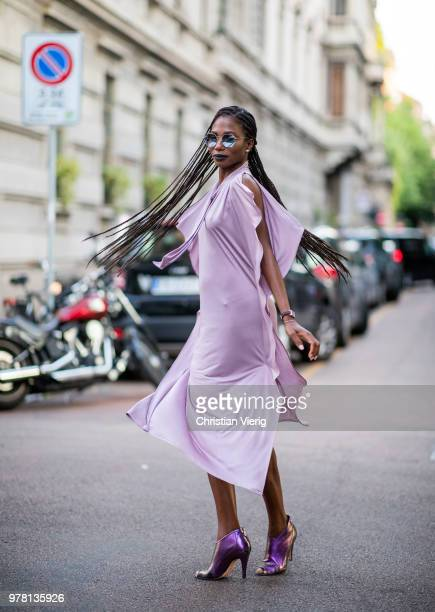 A guest wearing braids pink dress is seen outside Stella McCartney during Milan Men's Fashion Week Spring/Summer 2019 on June 18 2018 in Milan Italy