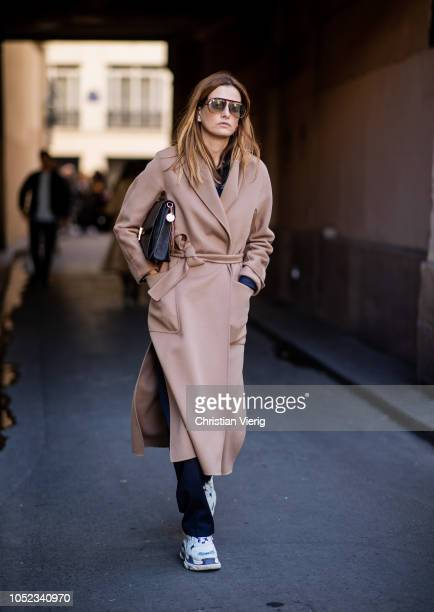 A guest wearing brown belted coat is seen outside APC during Paris Fashion Week Womenswear Spring/Summer 2019 on October 1 2018 in Paris France