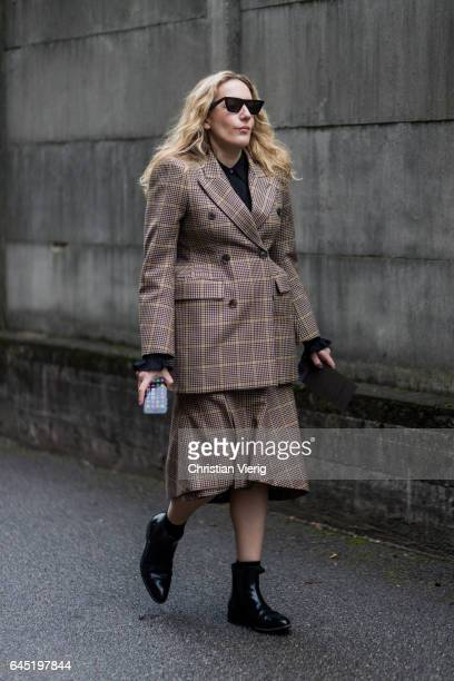 A guest wearing brown checked blazer and skirt outside Diesel during Milan Fashion Week Fall/Winter 2017/18 on February 24 2017 in Milan Italy