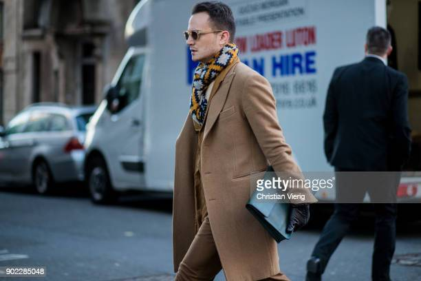 A guest wearing brown coat during London Fashion Week Men's January 2018 on January 7 2018 in London England