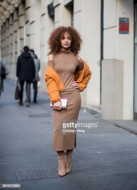 A guest wearing brown dress is seen outside Daks during Milan Men's Fashion Week Fall/Winter 2018/19 on January 14 2018 in Milan Italy