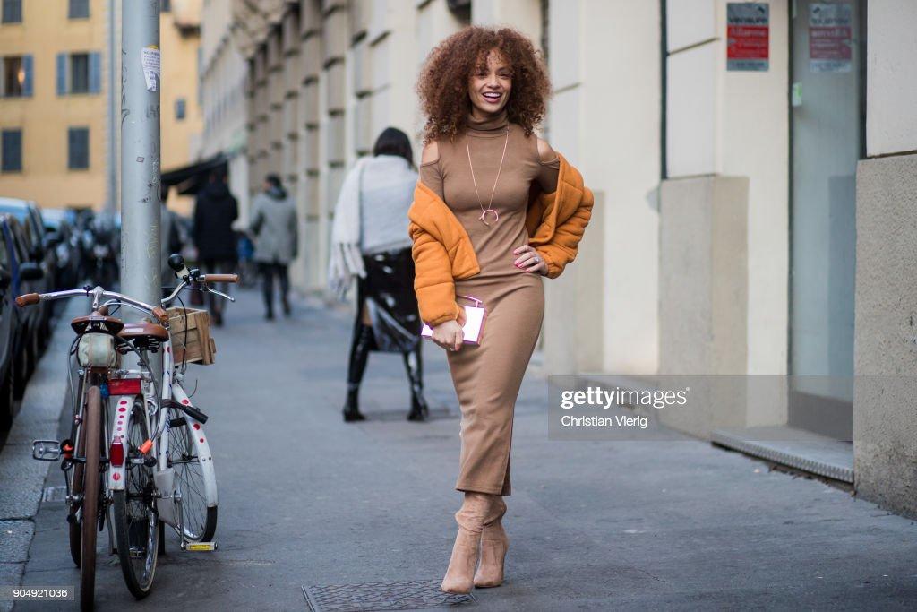 A guest wearing brown dress is seen outside Daks during Milan Men's Fashion Week Fall/Winter 2018/19 on January 14, 2018 in Milan, Italy.