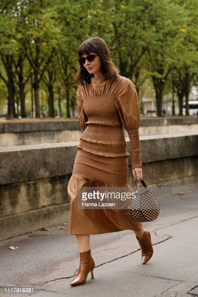 Guest wearing brown dress outside Valentino during Paris Fashion Week Womenswear Spring Summer 2020 on September 29, 2019 in Paris, France.