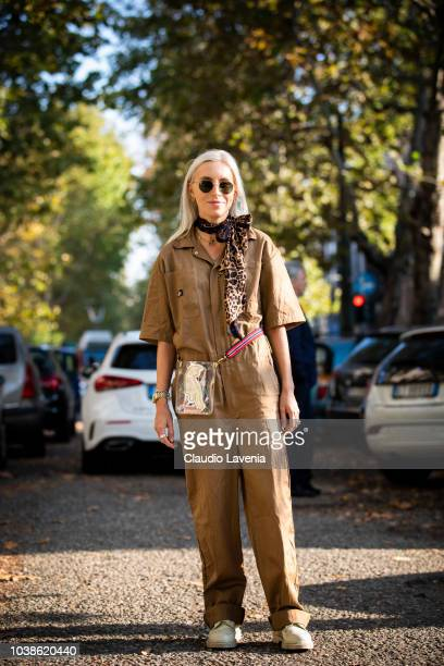 A guest wearing brown jumpsuit and transparent belt bag is seen before the Marni show during Milan Fashion Week Spring/Summer 2019 on September 23...