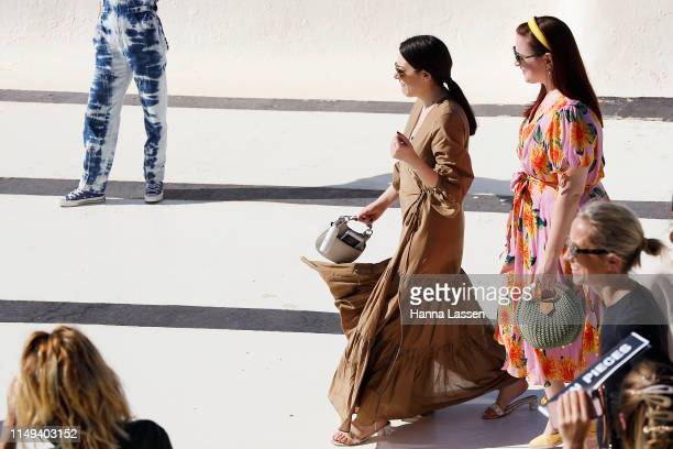 A guest wearing brown maxi wrap dress at MercedesBenz Fashion Week Resort 20 Collections on May 16 2019 in Sydney Australia