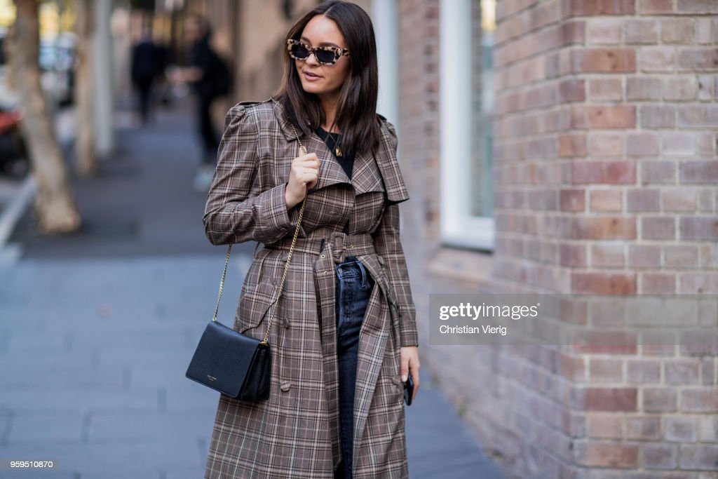 A guest wearing brown plaid coat, slingbacks, cropped denim jeans during Mercedes-Benz Fashion Week Resort 19 Collections at Carriageworks on May 17, 2018 in Sydney, Australia.