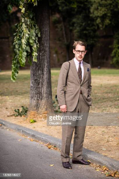 Guest, wearing brown suits, is seen at Fortezza Da Basso on July 01, 2021 in Florence, Italy.