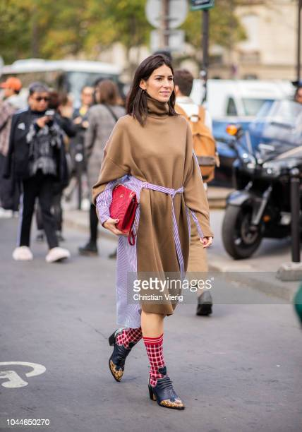 A guest wearing brown two tone dress is seen outside Sacai during Paris Fashion Week Womenswear Spring/Summer 2019 on October 1 2018 in Paris France